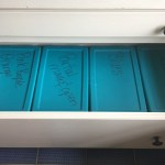 tubs labeled storage and organization inside drawer