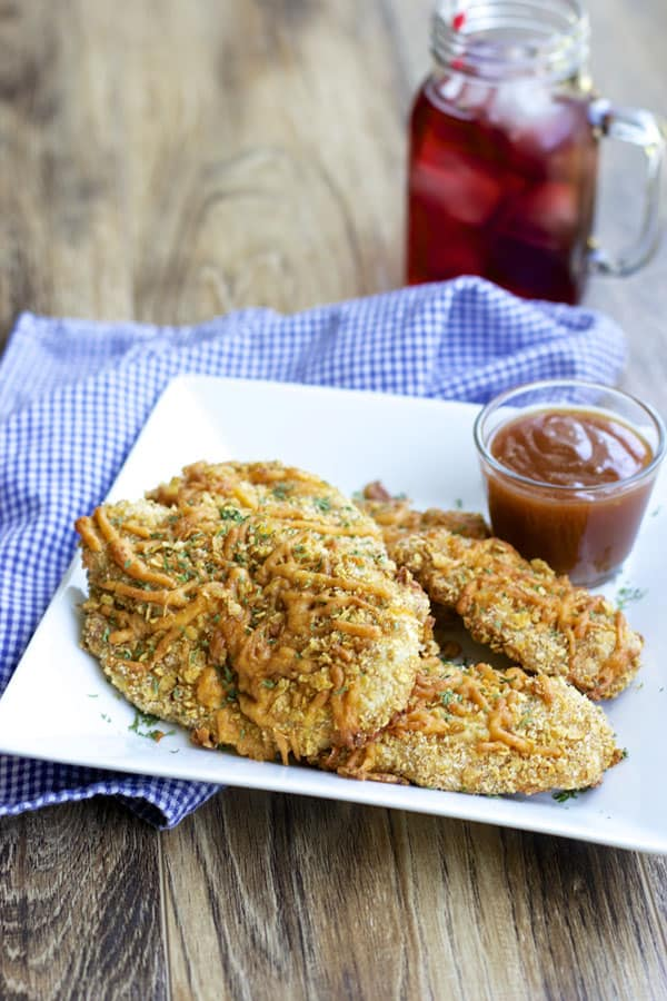 Parmesan Chicken Fingers make a delicious easy dinner or party appetizer. Make a few batches and store them in the freezer. | 365 Days of Easy Recipes