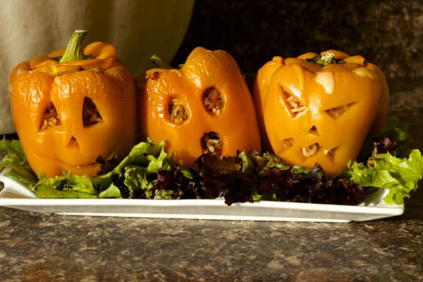 These jack-o'-lantern stuffed peppers have a combination of rice, ground beef and taco seasoning for a delicious yet healthy Halloween dinner | 365 Days of Easy Recipes