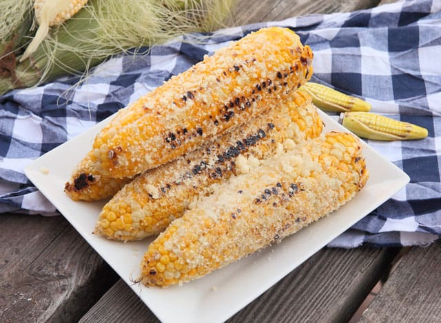 This recipe for grilled parmesan corn takes delicious corn on the cob and makes it extraordinary with just a few simple ingredients