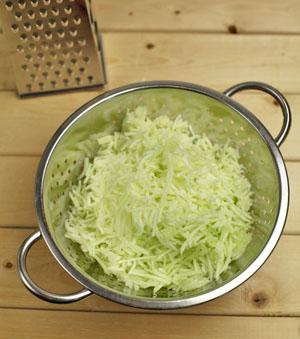 Shredded zucchini in colander