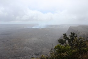 Halema`uma`u Crater and the steam rising from it.