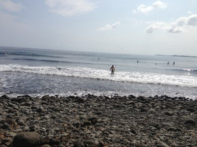 The surfers at Honoli'i Beach Park.