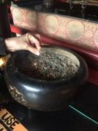 Linda lighting incense.