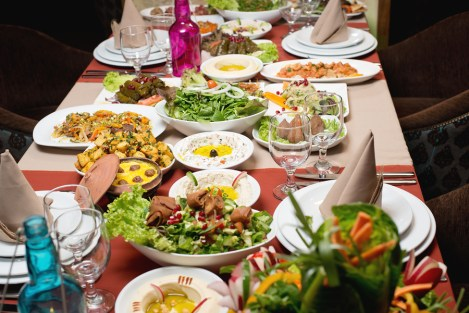 Table with various food served in a restaurant