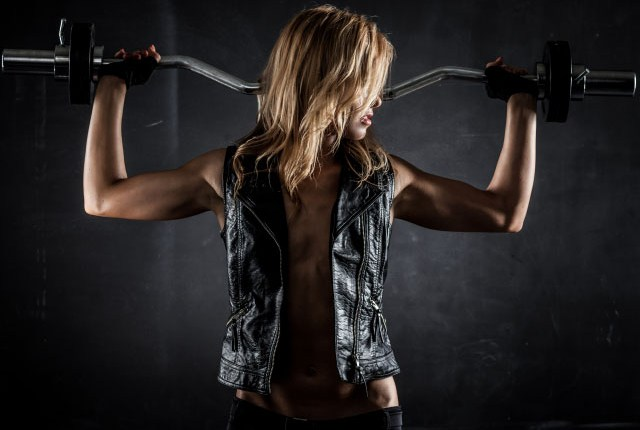 woman-pumping-up-muscles-barbell