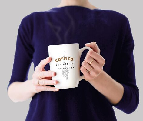 Woman Holding A Coffee Mug Mockup PSD