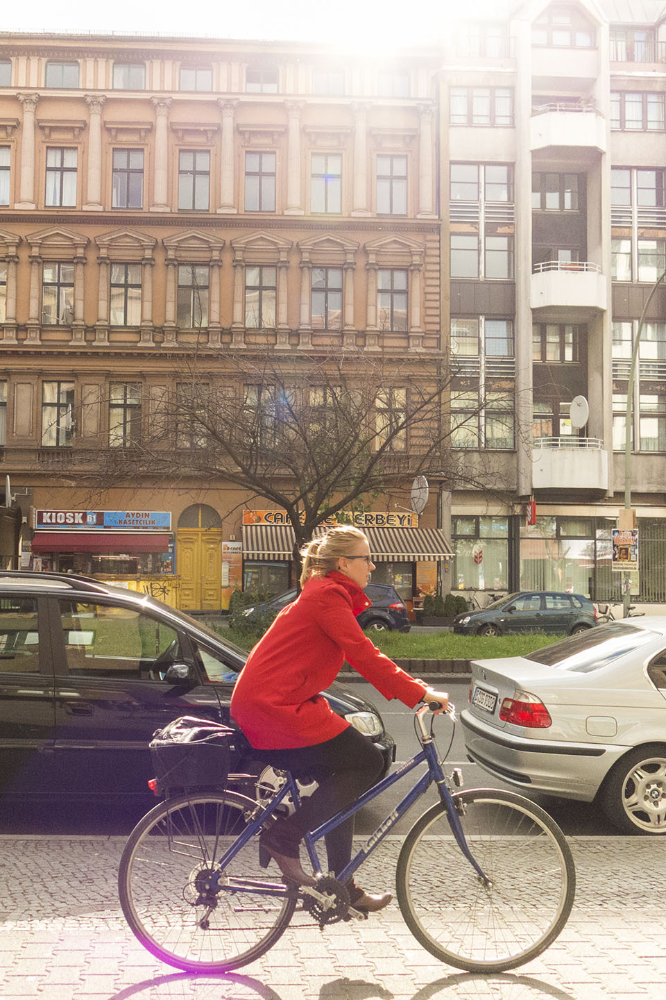A woman in red bikes in Berlin.