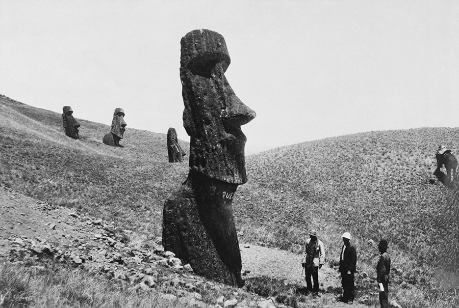 Men observe the giant statues of Easter Island in Polynesia, December 1922.Photograph by J. P. Ault, National Geographic