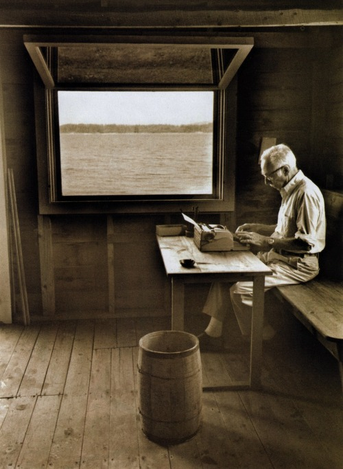 E. B. White writing in his boat shed overlooking Allen Cove, 1976, using a portable manual typewriter.  Photo by Jill Krementz, from  her book, The Writer's Image.