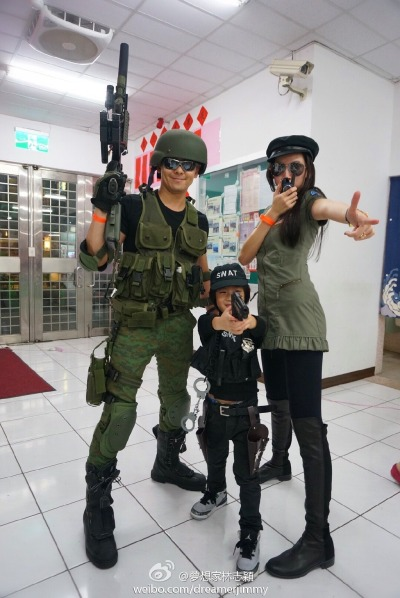 Jimmy Lin, wife Kelly Chen, and son Kimi Lin dressed up as SWAT officders for Halloween