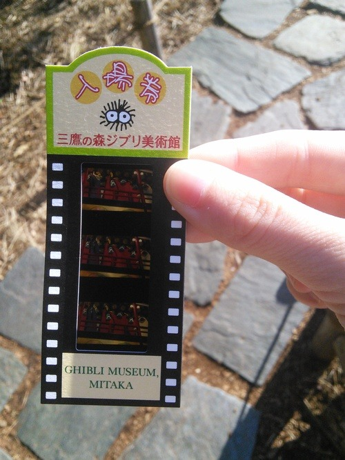 A short strip of three film frames, surrounded by a cardboard frame.