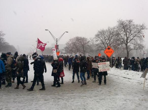 Members of CUPE 3903 join the picket line at the main gate of York University.