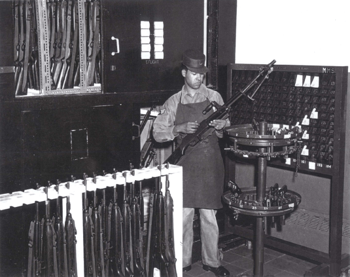 905x715 Gun rm A1C Lawrence Gomez inspecting BAR 1961