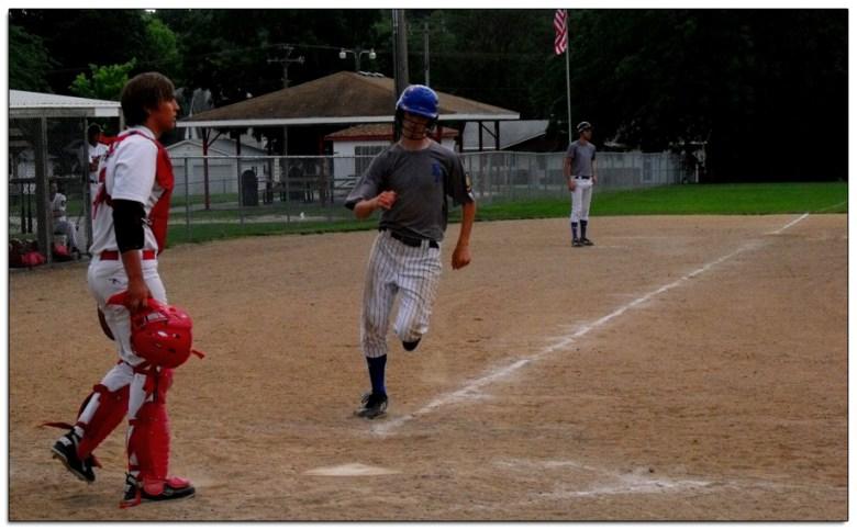 Running for home during summer legion baseball