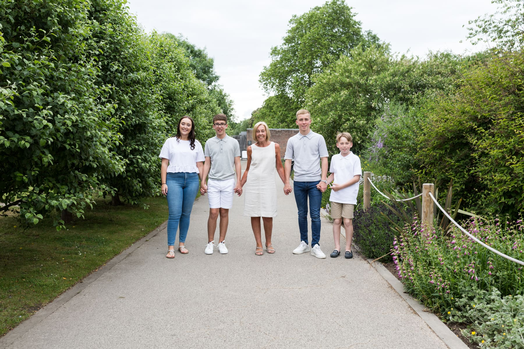 Nana holding hands with her four grandchildren at their Bexley extended family photoshoot