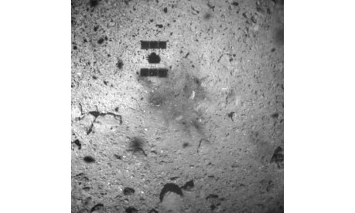 Japan says space probe landed on asteroid to get soil sample