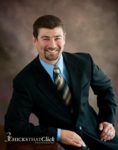 executive portrait of man wearing suit & tie