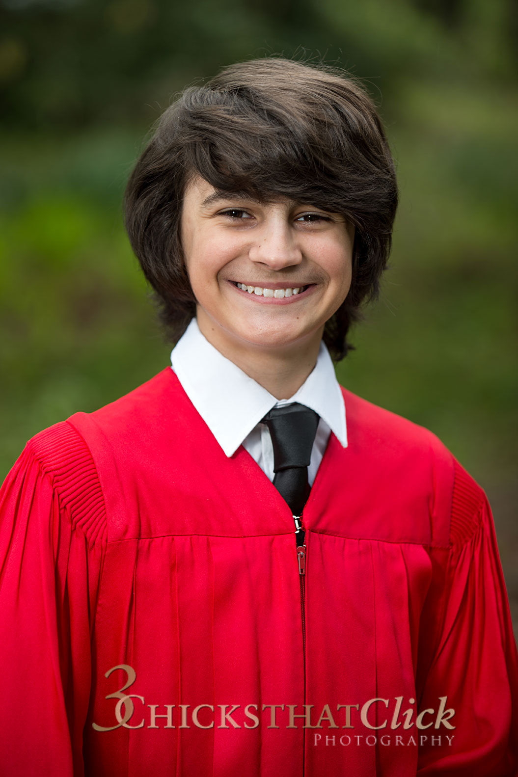 Photo of young man in red Confirmation gown