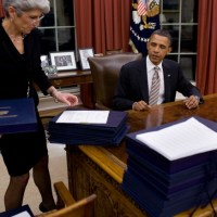 President Obama Signs 35 Bills Into Law, Post Vacation
