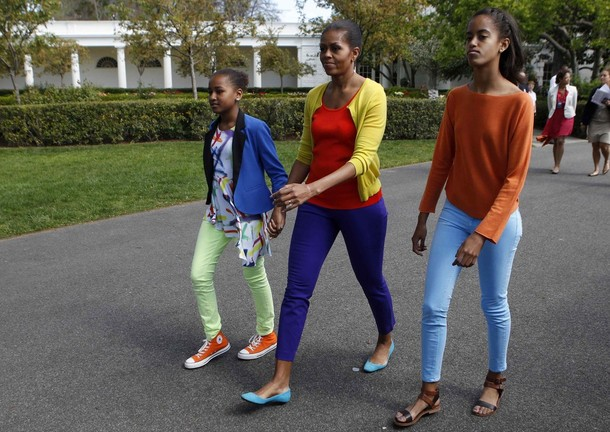 First lady Michelle Obama and kids walk at 2012 White House Easter Egg Roll at the White House in Washington