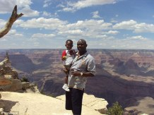 Hezekiah Darbon and his father Joseph at the Grand Canyon - Joseph and his wife Dawn couldn't be with their son in the aftermath of the deadly tornado on Monday because they were at work