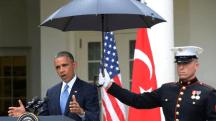 Marines hold umbrellas over U.S. President Barack Obama10