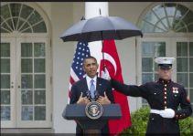 Marines hold umbrellas over U.S. President Barack Obama22