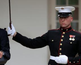 Marines hold umbrellas over U.S. President Barack Obama6