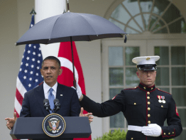 Marines hold umbrellas over U.S. President Barack Obama7