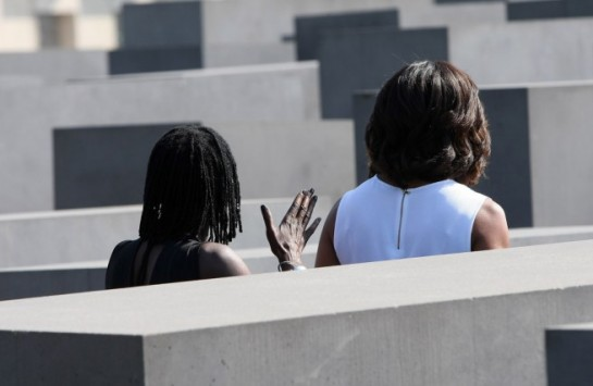 Auma Obama, President Barack Obama's half sister and First Lady Michelle Obama enter the Memorial to the Murdered Jews of Europe on June 19, 2013 in Berlin, Germany.