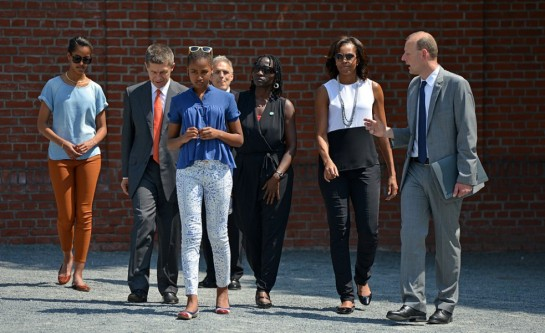First Lady Michelle Obama, with her daughters Malia and Sasha, Auma Obama, and German Chancellor's husband Joachim Sauer visit the Berlin Wall memorial at Bernauer Strasse on June 19, 2013 in Berlin, Germany.