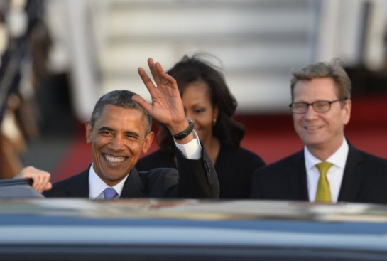 US President Barack Obama and US First Lady Michelle Obama are greeted by German foreign minister Guido Westerwelle (R) upon arrival at Berlin Tegel airport on June 18, 2013. Barack Obama will walk in John F. Kennedy's footsteps this week on his first visit to Berlin as US president, but encounter a more powerful and sceptical Germany in talks on trade and secret surveillance practices.  AFP PHOTO / ODD ANDERSEN