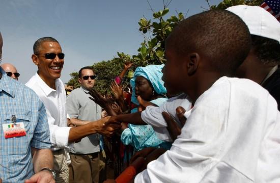U.S. President Barack Obama greets well-wishers during his visit to Goree Island near Dakar