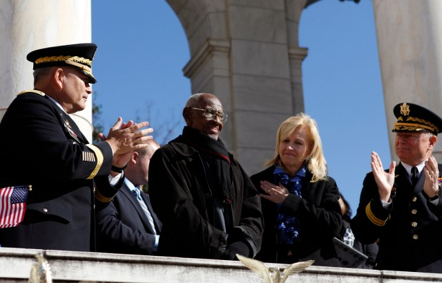 RICHARD OVERTON RECEIVES A STANDING OVATION AFTER U.S. PRESIDENT OBAMA PAID TRIBUTE TO HIM DURING A VETERANS DAY CEREMONY AT ARLINGTON NATIONAL CEMETERY IN WASHINGTON