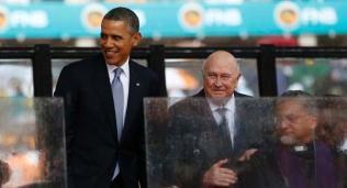 Former South African President De Klerk watches as U.S. President Obama arrives to speak during a memorial service in Johannesburg