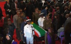 At the end of the memorial ceremony a military guard of honour carried Mr Mandela's coffin, draped in the South African flag, out of the marquee as the audience sang.