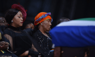 Mandela's daughter Makaziwe, centre, sits in front of her father's coffin during the ceremony