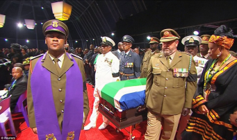 State funeral: Mandela's coffin is carried into the white tent for the service by senior military figures and an Army chaplain