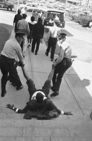 dr-king-rev-avery-alexander-of-new-orleans-is-dragged-feet-first-towards-paddy-wagon-by-police-after-he-led-on-unsecessful-sit-in-demonstration-in-city-hall-in-new-orleans-oct-31-1963.