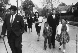 Dr. King- 1964- Walking to church with his family.