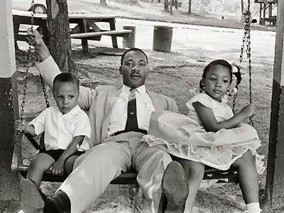 DR KING AND HIS KIDS SWINGING