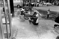 Dr King - Black youth demonstrators sit on the sidewalk with hands behind their heads as high pressure hoses are turned on their backs in Birmingham, Ala.
