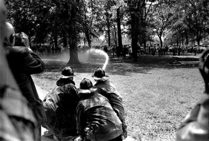 Dr King - Firemen direct high pressure water hoses from a long range, at a group of blacks in a wooded section in Birmingham, Ala., May 4, 1963, as racial protest demonstrations continued.