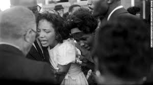 Dr. King- Mourners embrace at the funeral.