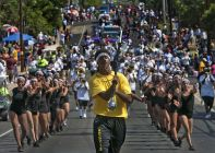 Juneteenth celebration- Drum major Anthony Gilbert, 17, a recent graduate of Eastside Memorial High, leads the Austin All Star Marching Band during the parade Saturday. Rodolfo Gonzalez