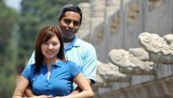 Faces of MH370-Canadian passengers Muktesh Mukherjee 42 and his wife Xiaomo Bai 37 Photo- facebook