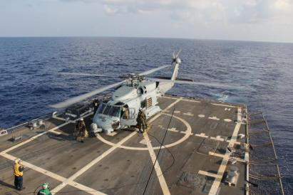 Ships and planes looking for MH370- A U.S. Navy MH-60R Sea Hawk helicopter lands aboard the USS Pinckney during a crew swap before returning on task in the search and rescue for the missing Malaysian airlines