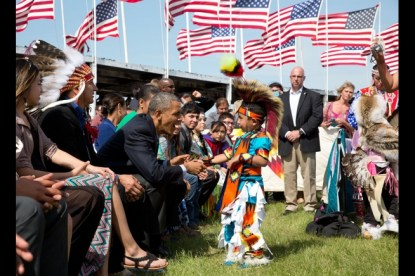 Barack Obama greets a young boy during the Cannon Ball Flag Day Celebration at the Cannon Ball powwow grounds during a visit to the Standing Rock Sioux Tribe Reservation in Cannon Ball, N.D., June 13, 2014.