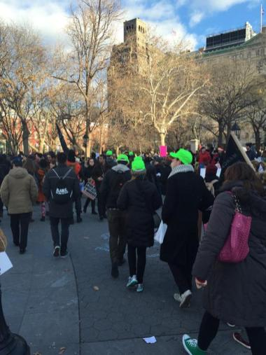 Justice4All March43 green hats means legal observers ensuring arrests are reported
